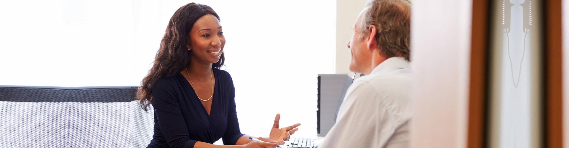 a woman and an elderly man talking